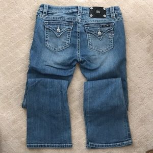 EUC Miss Me Mid-rise boot cut jeans